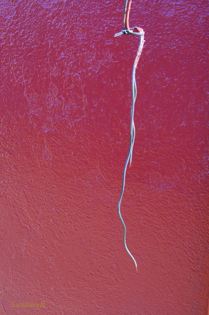 electricity-loose wire-red wall-photography-SwittersB