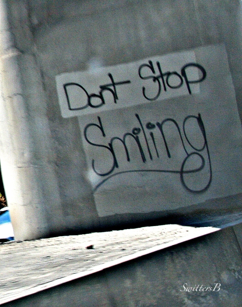 freeway-graffiti-sign-tag-smile-mental health-photography-SwittersB
