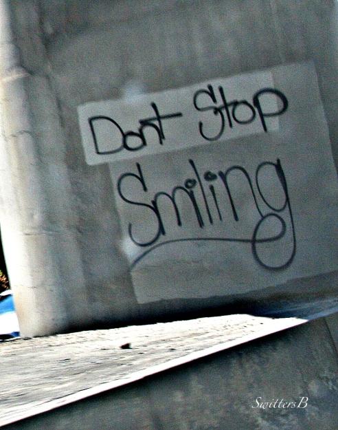 freeway-graffiti-sign-tag-smile-mental health-photography-SwittersB