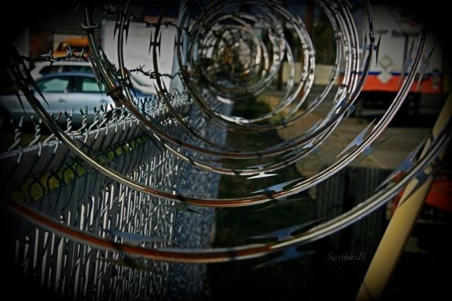 razor wire-spiral-urban-industrial-photography-SwittersB