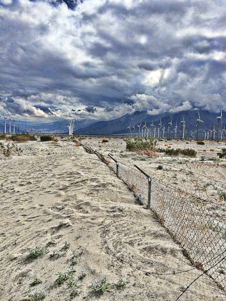 wind turbines-sand-buried fence-California