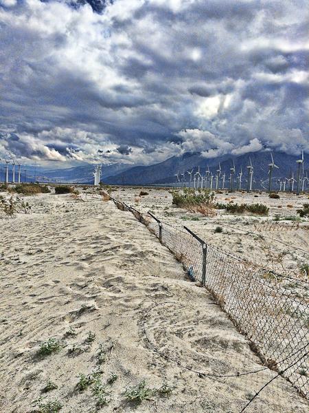 wind turbines-sand-buried fence-California